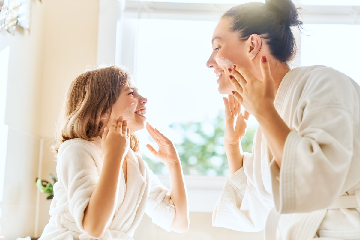 mother and daughter caring for skin